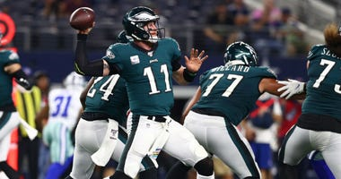 Philadelphia Eagles quarterback Carson Wentz (11) throws in the pocket in the third quarter against the Dallas Cowboys at AT&T Stadium.