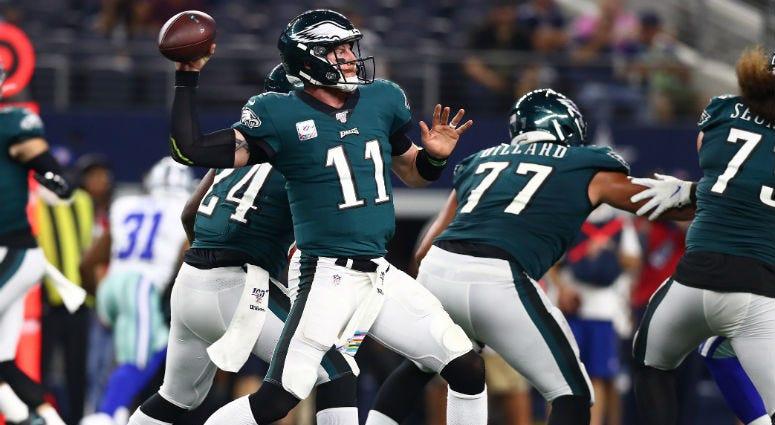 Philadelphia Eagles quarterback Carson Wentz (11) throws in the pocket in the third quarter against the Dallas Cowboys at AT&T Stadium.