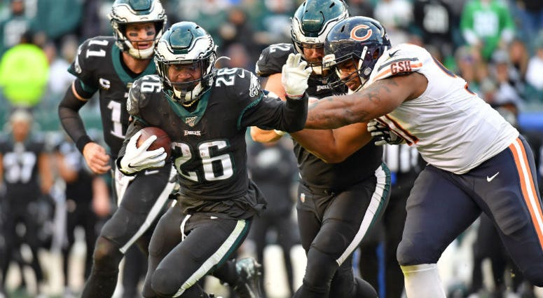 Philadelphia Eagles running back Jordan Howard (24) runs past Chicago Bears nose tackle Eddie Goldman (91) during the fourth quarter at Lincoln Financial Field.
