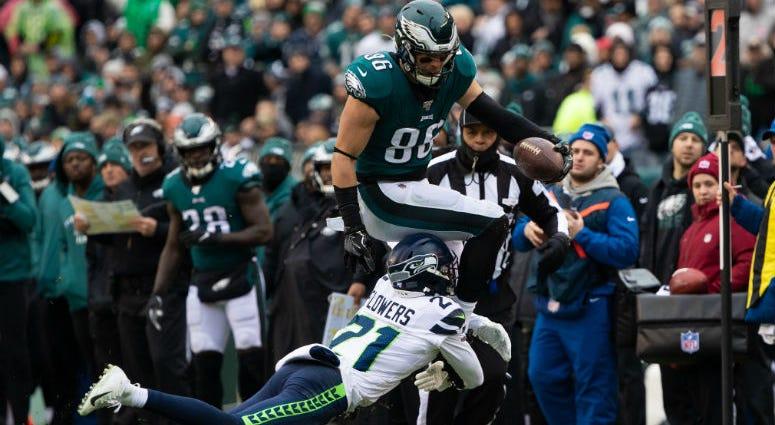 Philadelphia Eagles tight end Zach Ertz (86) is brought down by Seattle Seahawks cornerback Tre Flowers (21).