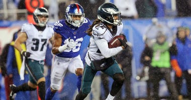 Philadelphia Eagles cornerback Sidney Jones (22) runs back an interception against New York Giants wide receiver Darius Slayton (86) during the fourth quarter at MetLife Stadium.