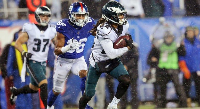 Philadelphia Eagles cornerback Sidney Jones (22) runs back an interception against New York Giants wide receiver Darius Slayton (86) during the fourth quarter at MetLife Stadium.
