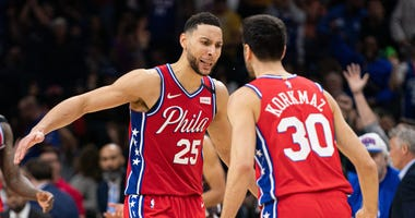 Philadelphia 76ers guard Ben Simmons (25) reacts to guard Furkan Korkmaz (30) score during the fourth quarter against the Brooklyn Nets at Wells Fargo Center.