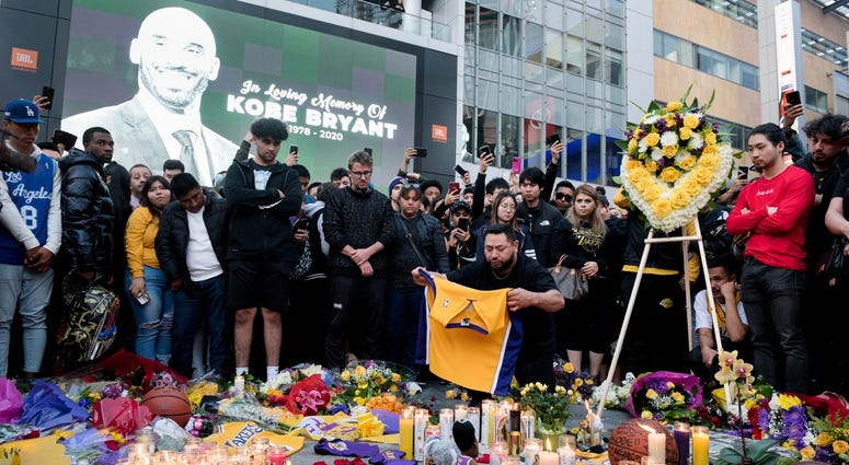 Fans gather at L.A. Live in Los Angeles to pay their respects to former Los Angeles Lakers guard Kobe Bryant who died in helicopter crash on Sunday.