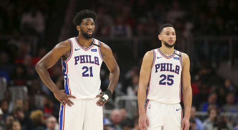 Philadelphia 76ers center Joel Embiid (21) and guard Ben Simmons (25) during a free throw against the Atlanta Hawks in the second quarter at State Farm Arena.