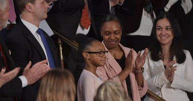 Stephanie and Janiyah Davis are applauded as they sit in the First Lady's box as President Donald J. Trump delivers the State of the Union address from the House chamber of the United States Capitol in Washington.