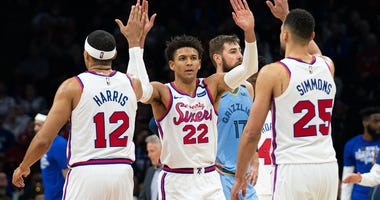 Philadelphia 76ers guard Matisse Thybulle (22) celebrates his score with forward Tobias Harris (12) and guard Ben Simmons (25)
