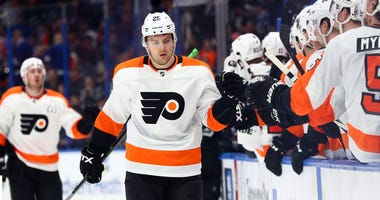 Philadelphia Flyers left wing James van Riemsdyk (25)] is congratulated as he scores a goal