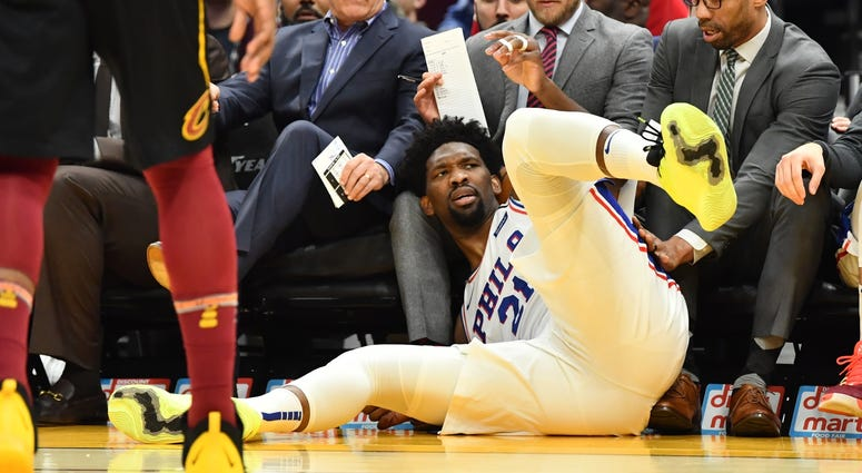 Philadelphia 76ers center Joel Embiid (21) stares back at the court after diving out of bounds into the 76ers bench during the first half against the Cleveland Cavaliers at Rocket Mortgage FieldHouse.