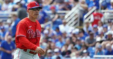 Philadelphia Phillies manager Joe Girardi (25) walks to make a pitching change against the Toronto Blue Jays during the third inning at TD Ballpark.