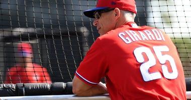 Philadelphia Phillies manager Joe Girardi (25) watches his team warm up