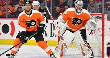 Mar 10, 2020; Philadelphia, Pennsylvania, USA; Philadelphia Flyers defenseman Matt Niskanen (15) and Philadelphia Flyers goaltender Carter Hart (79)