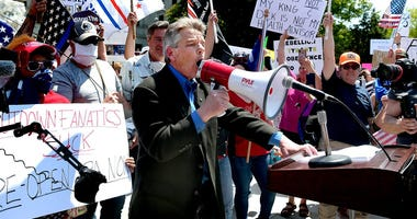 Protesters broke through barriers to gather around speaker, State Rep. Russ Diamond, R-Lebanon, who gave a speech during a Reopen PA rally in Harrisburg Friday, May 15, 2020