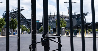 General view of Lincoln Financial Field behind a locked entrance gate.