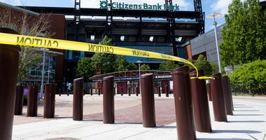 General view of Citizens Bank Park with caution tape draped around entrance area.