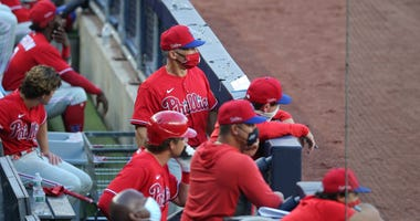 Philadelphia Phillies manager Joe Girardi looks on from the dugout