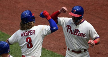 Philadelphia Phillies right fielder Bryce Harper (3) celebrates with first baseman Rhys Hoskins (17) after his three-run home run in the first inning against the Miami Marlins at Citizens Bank Park.