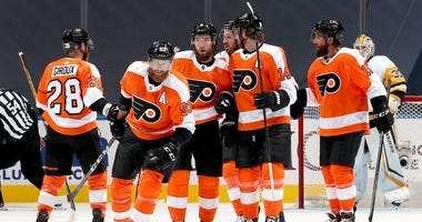 Jakub Voracek #93 of the Philadelphia Flyers celebrates a goal by teammate Sean Couturier #14