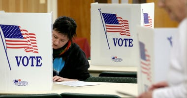 Amber McAlister votes during the New York presidential primary election at the Lutheran Church on Winton Road.