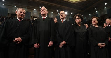 Chief Justice John Roberts (L) and Supreme Court Justices (2L-R) Anthony Kennedy, Stephen G. Breyer, Sonia Sotomayor and Elena Kagan arrive for a joint session of Congress address by President Donald Trump at the U.S. Capitol in February 2017.