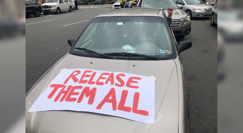 Protesters in cars demand low-risk inmates released