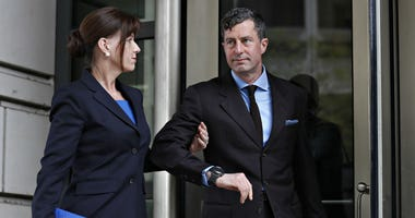 W. Samuel Patten, right, with his wife, leaves federal court after being sentenced to three years probation in the Trump Russia Probe case, Friday April 12, 2019, in Washington.
