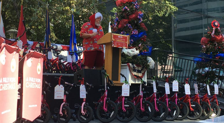 Comcast and the Philly Pops teamed up to give 205 bikes away for Christmas in July.