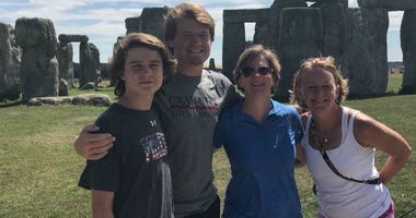 Alicia Terrizzi and Loreen Bloodgood are shown at Stonehenge with their two sons.