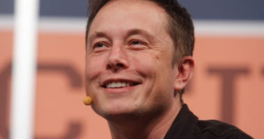 In this March 9, 2013, file photo, Electric car maker Tesla's CEO Elon Musk gives the opening keynote at the SXSW Interactive Festival in Austin, Texas.