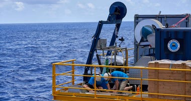 Technicians conduct maintenance on the Remote Operated Vehicle (ROV) as the British-based Nekton Mission sails to a dive site in the Seychelles on Wednesday March 6, 2019.