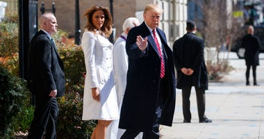 President Donald Trump and first lady Melania Trump, with Reverend Bruce McPherson, walk to their motorcade after attending service at Saint John's Church in Washington, Sunday, March 17, 2019, en route to the White House. (