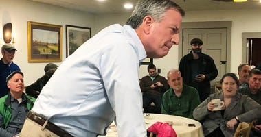 New York Mayor Bill de Blasio listens as he speaks before a group of people at a restaurant in Concord, N.H., Sunday, March 17, 2019. Blasio on Sunday criticized former President Barack Obama during the small gathering as he mulls a run for president, say