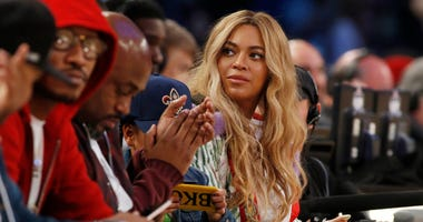 """FILE - In this Feb. 19, 2017. file photo, Beyonce sits at court side during the second half of the NBA All-Star basketball game in New Orleans. Netflix on Sunday, April 7, 2019 posted on its social media channels a yellow image with the word """"Homecoming"""""""