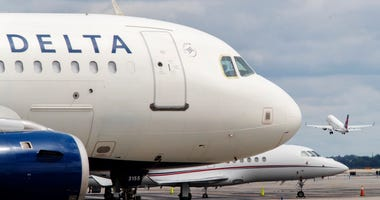 A Delta Air Lines jet waits on the tarmac at LaGuardia Airport in New York.
