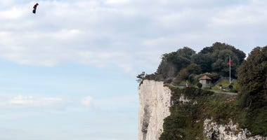 French inventor Franky Zapata lands near St. Margaret's beach, Dover after crossing the Channel on a flying board Sunday, Aug. 4, 2019.