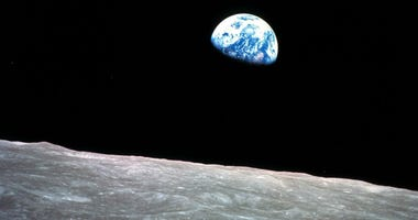 This Dec. 24, 1968, file photo made available by NASA shows the Earth behind the surface of the moon during the Apollo 8 mission.