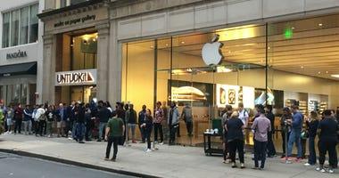 Shoppers line up outside of the Apple store on Walnut Street in Center City Philadelphia.