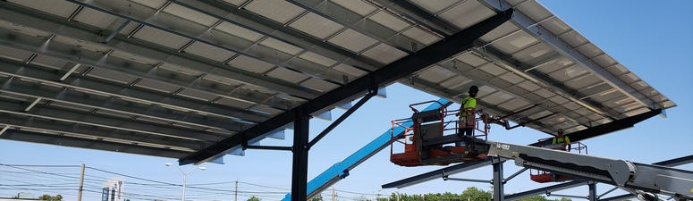 Workers construct the solar cell canopies that will ultimately provide 22 megawatts of power to the Delaware River Port Authority.
