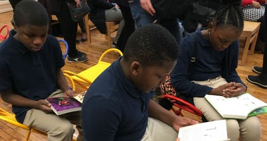 Students read at the re-opened library at Bache-Martin Elementary in Fairmount.