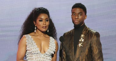 "Angela Bassett, left, and Chadwick Boseman, nominated for outstanding performance by a cast in a motion picture, introduce a clip from their film ""Black Panther"" at the 25th annual Screen Actors Guild Awards at the Shrine Auditorium & Expo Hall in L.A."