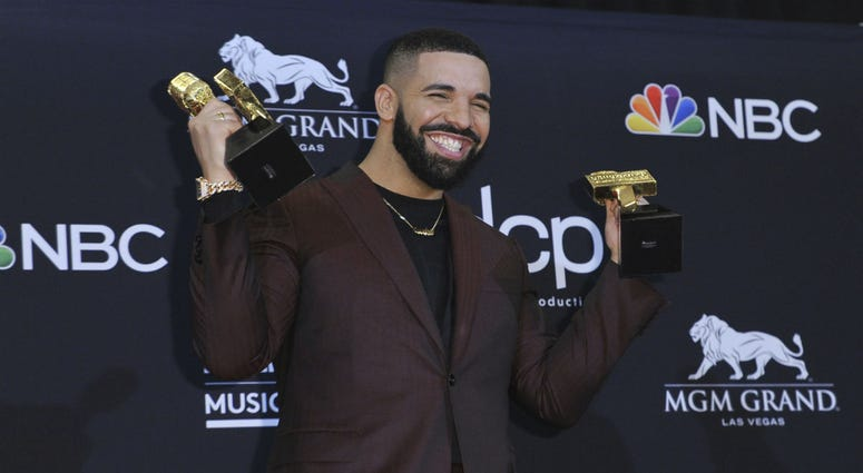 Drake poses in the press room with his awards at the Billboard Music Awards on Wednesday, May 1, 2019, at the MGM Grand Garden Arena in Las Vegas.