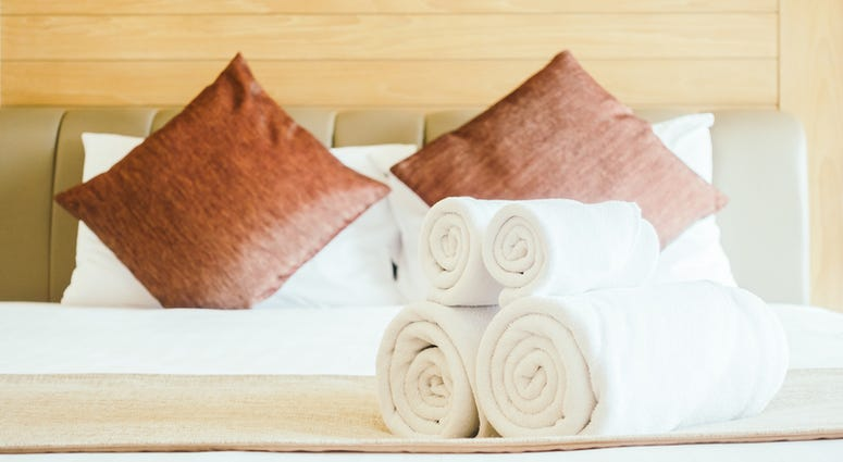 White bath towel on bed decoration in bedroom interior