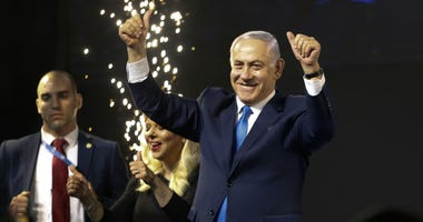 Israel's Prime Minister Benjamin Netanyahu waves to his supporters after polls for Israel's general elections closed in Tel Aviv, Israel, Wednesday, April 10, 2019.