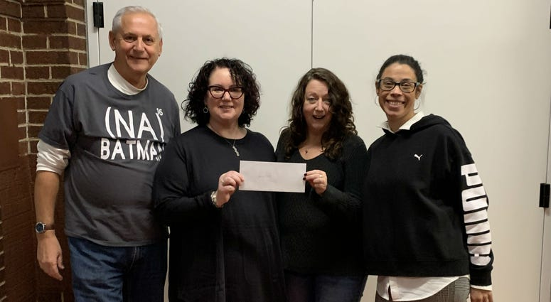 From left: Bob Curran, business manager of Better than Bacon; Lauren Henry, creative director of Better Than Bacon; Hallie Romanowski, executive director of Act In Faith; April Evans, assistant director of Uptown Knauer Performing Arts Center.