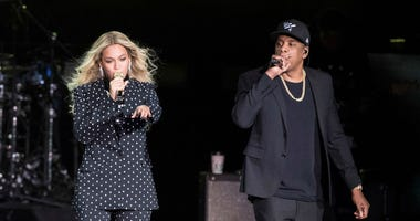 In this Nov. 4, 2016 file photo, Beyonce and Jay-Z perform during a Democratic presidential candidate Hillary Clinton campaign rally in Cleveland.