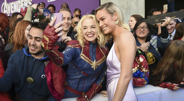 "Brie Larson takes a selfie with a fan as she arrives at the premiere of ""Avengers: Endgame"" at the Los Angeles Convention Center on Monday, April 22, 2019."