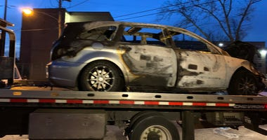 Police say this car was set on fire overnight on Fishers Lane, not far from Broad Street in the Logan section of Philadelphia.