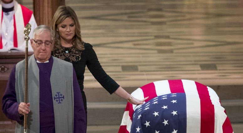 Jenna Bush Hager, the daughter of former President George Bush, touches the casket of former President George H.W. Bush after speaking at his State Funeral at the National Cathedral, December 5, 2018 in Washington, DC.