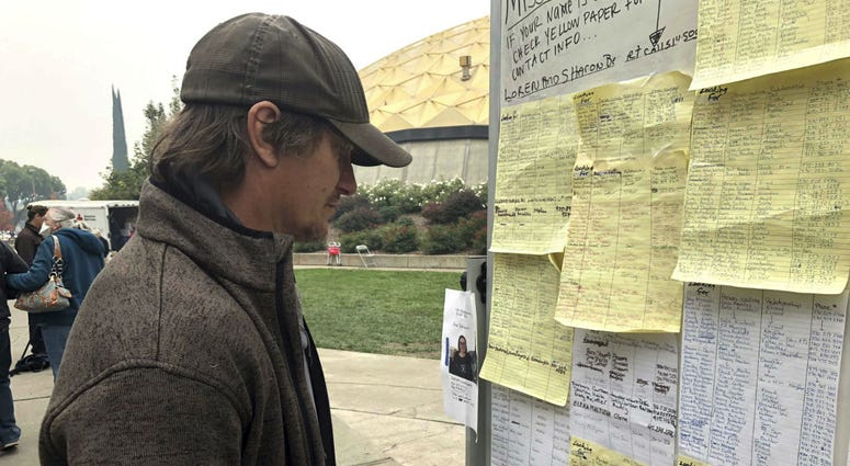 Wildfire evacuee Greg Gibson looks for information about his missing neighbors at The Neighborhood Church in Chico, Calif., on Tuesday, Nov. 13, 2018.