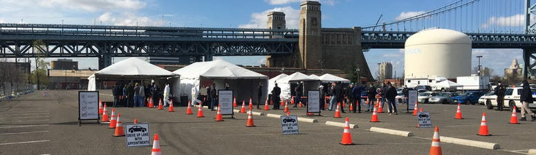 A drive-thru coronavirus testing site operates in Camden, N.J.